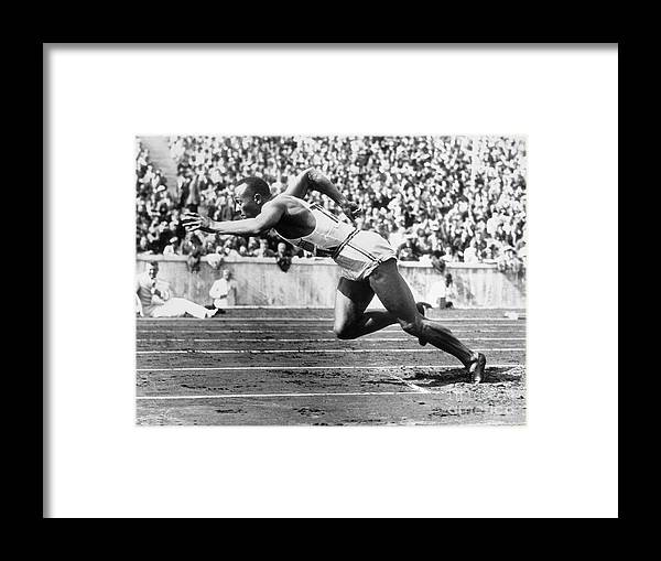 People Framed Print featuring the photograph Jesse Owens At Start Of Race by Bettmann