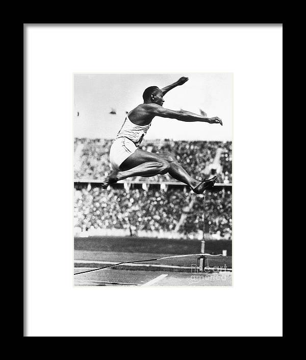 The Olympic Games Framed Print featuring the photograph Jesse Owens In Midair by Bettmann