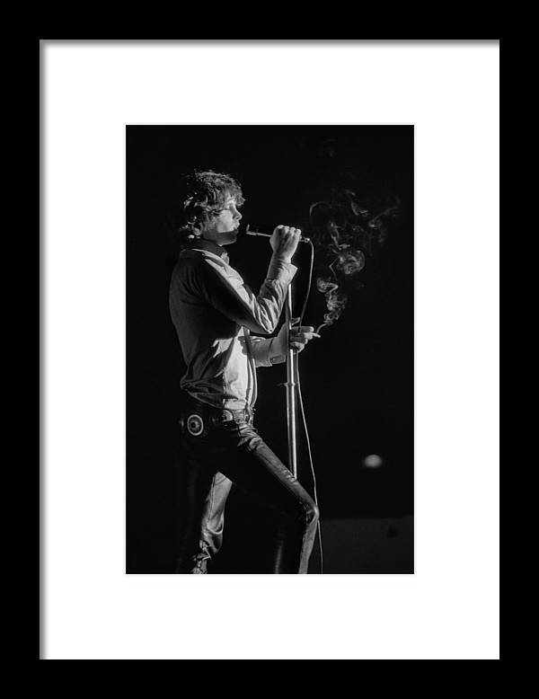 Rock Music Framed Print featuring the photograph Jim Morrison Live by Michael Ochs Archives