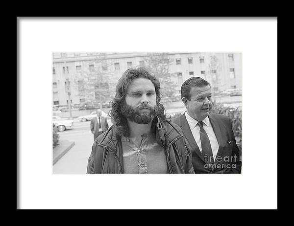 Singer Framed Print featuring the photograph Jim Morrison Walking To Extradition by Bettmann