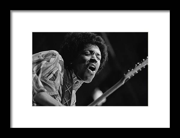 Rock Music Framed Print featuring the photograph Jimi Hendrix by Evening Standard