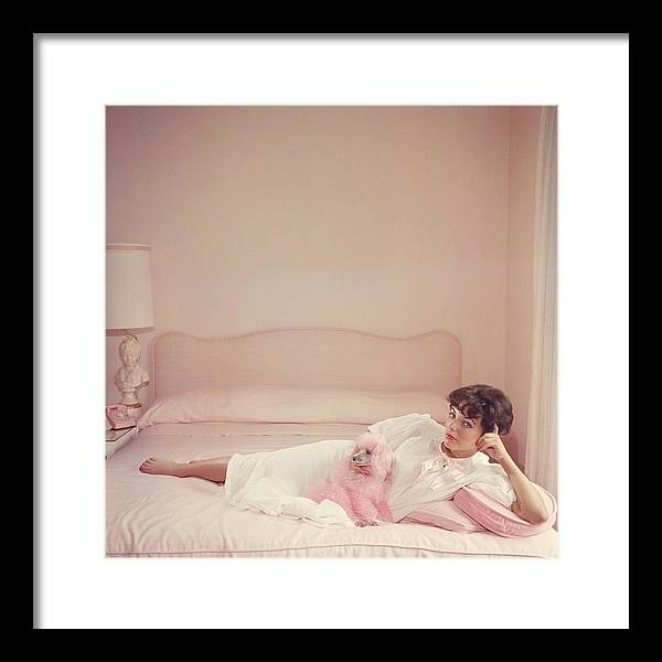 People Framed Print featuring the photograph Joan Collins Relaxes by Slim Aarons