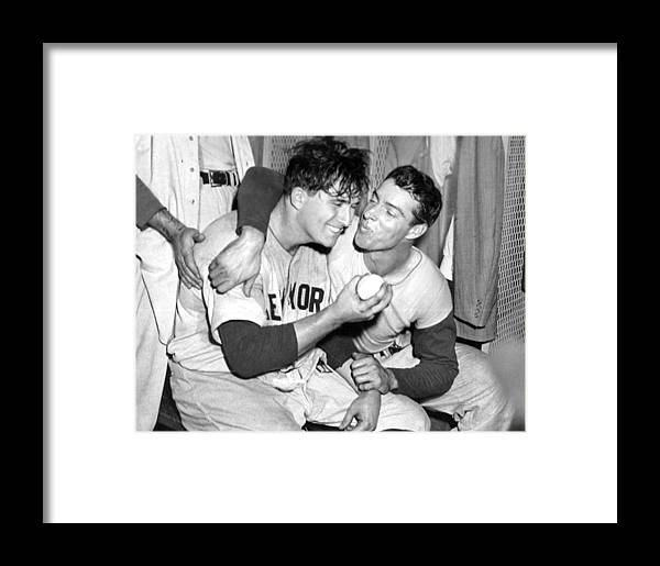 American League Baseball Framed Print featuring the photograph Joe Dimaggio Rewards Winning Pitcher by New York Daily News Archive