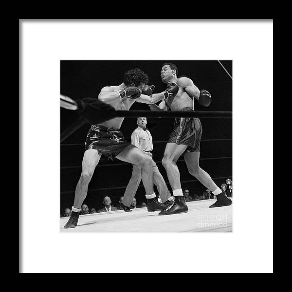 Mature Adult Framed Print featuring the photograph Joe Louis And Billy Conn In Boxing Match by Bettmann