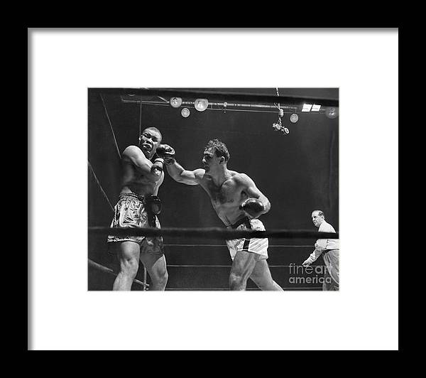 People Framed Print featuring the photograph Joe Louis And Rocky Marciano Boxing by Bettmann