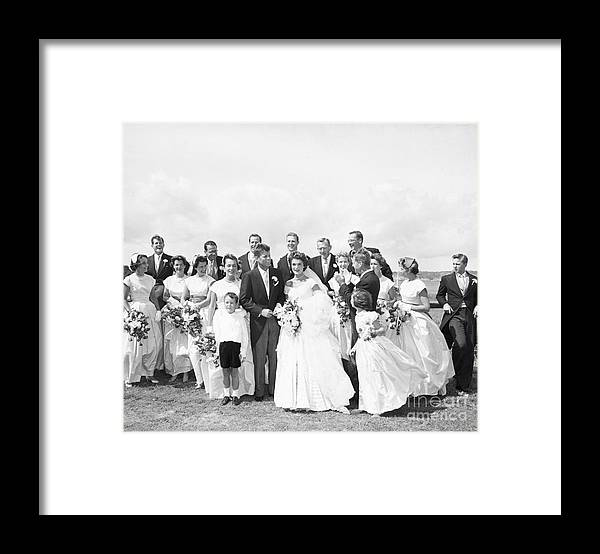 Young Men Framed Print featuring the photograph John And Jackie Kennedy On Wedding Day by Bettmann