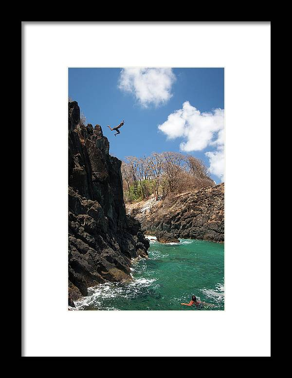 Tranquility Framed Print featuring the photograph Jumping by Mauricio M Favero