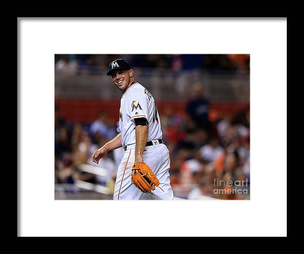 Looking Over Shoulder Framed Print featuring the photograph Kansas City Royals V Miami Marlins by Rob Foldy