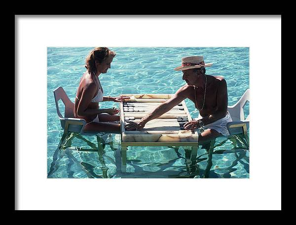 Straw Hat Framed Print featuring the photograph Keep Your Cool by Slim Aarons