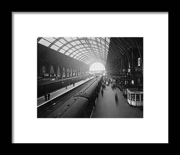 Passenger Train Framed Print featuring the photograph Kings Cross Station by Macgregor