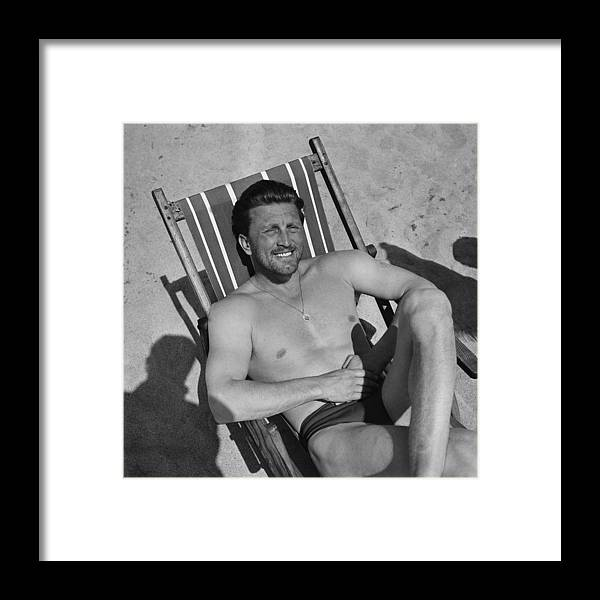 People Framed Print featuring the photograph Kirk Douglas In 1950s by Reporters Associes