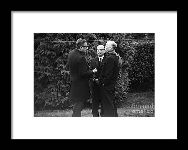 Vietnam War Framed Print featuring the photograph Kissinger And Le Duc Tho Talk by Bettmann
