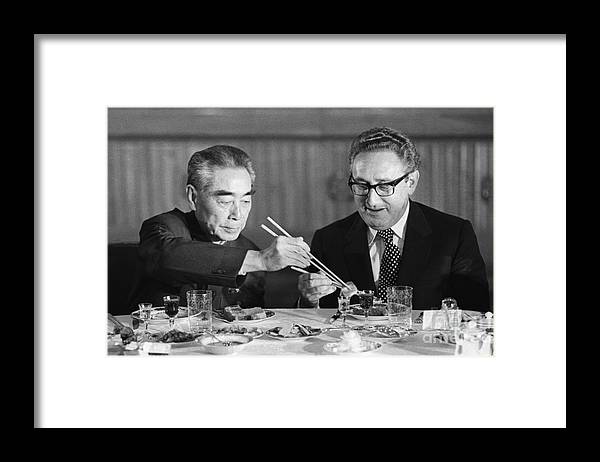 Chinese Culture Framed Print featuring the photograph Kissinger Eating With Zhou Enlai by Bettmann