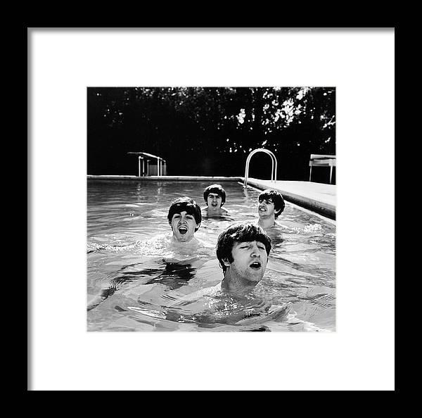 Singer Framed Print featuring the photograph L-r Paul Mccartney, George Harrison by John Loengard