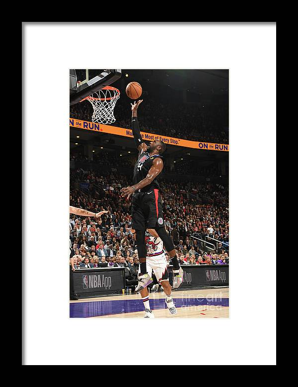 Patrick Patterson Framed Print featuring the photograph La Clippers V Toronto Raptors by Ron Turenne