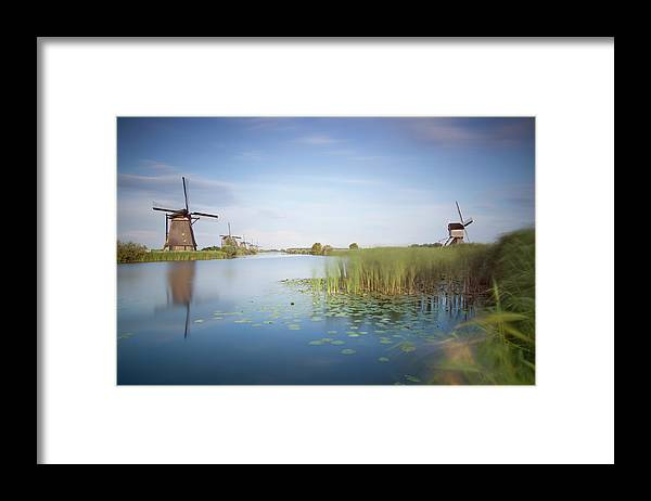 Tranquility Framed Print featuring the photograph Landscape With Windmills, Kinderdijk by Frank De Luyck