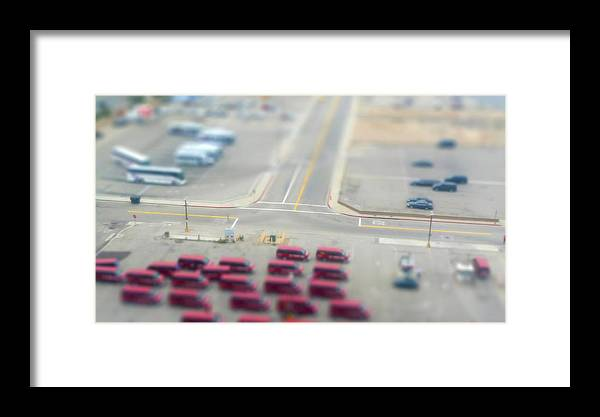 In A Row Framed Print featuring the photograph Lax Airport Parking Lot - Tilt Shift by John K. Goodman