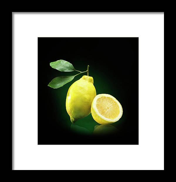 Black Background Framed Print featuring the photograph Lemon Slice by Jeremy Hudson