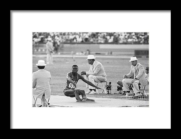 1980-1989 Framed Print featuring the photograph Lewis In The Long Jump At Olympics by Bettmann