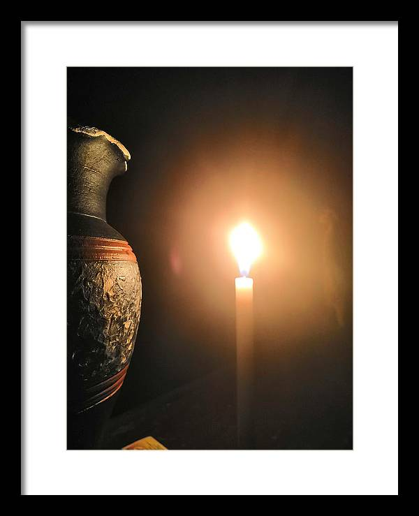 Candle Light Framed Print featuring the photograph Light in the dark by Ian Batanda