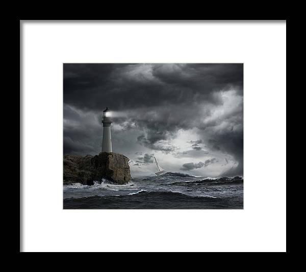 Risk Framed Print featuring the photograph Lighthouse Shining Over Stormy Ocean by John M Lund Photography Inc