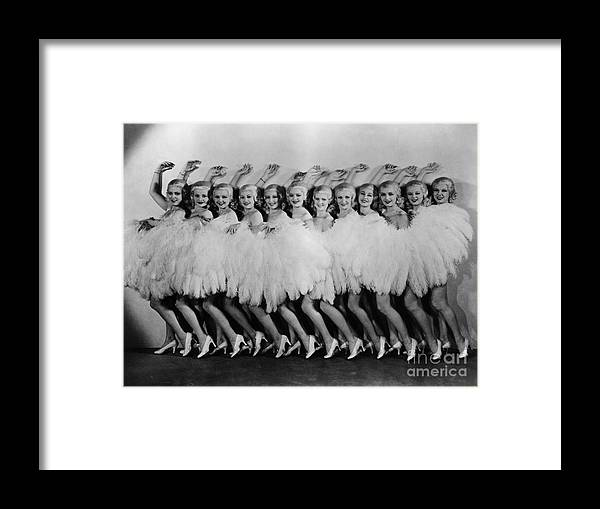 Dozen Framed Print featuring the photograph Line Of Chorus Girls In Feathered by Bettmann