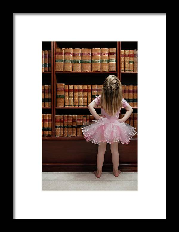 Education Framed Print featuring the photograph Little Girl In Tutu Reading Book Covers by Compassionate Eye Foundation/barry Calhoun
