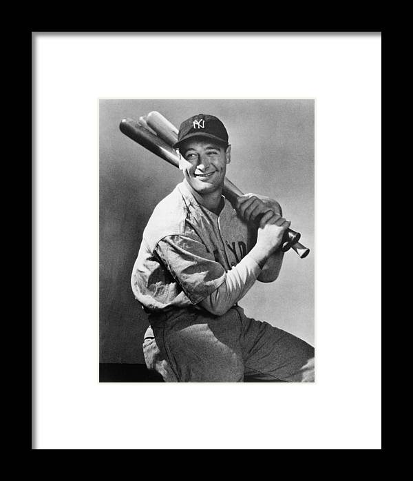 People Framed Print featuring the photograph Lou Gehrig Holding Three Baseball Bats by Pictorial Parade