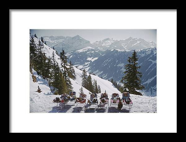 Gstaad Framed Print featuring the photograph Lounging In Gstaad by Slim Aarons