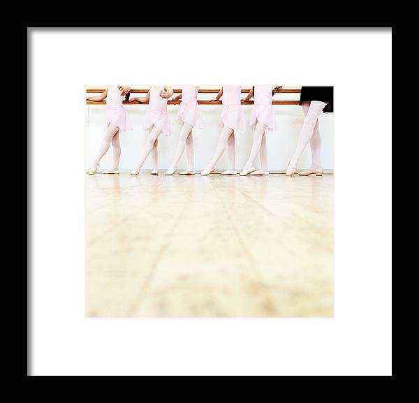 Ballet Dancer Framed Print featuring the photograph Low Section View Of A Line Of Young by Digital Vision.