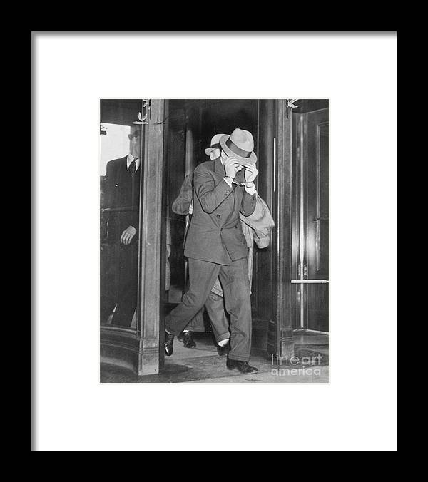 People Framed Print featuring the photograph Lucky Luciano Entering Courthouse by Bettmann