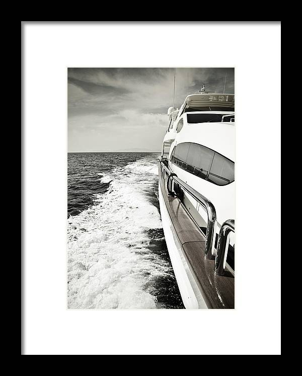 Desaturated Framed Print featuring the photograph Luxury Yacht Sailing At High Speed In by Petreplesea