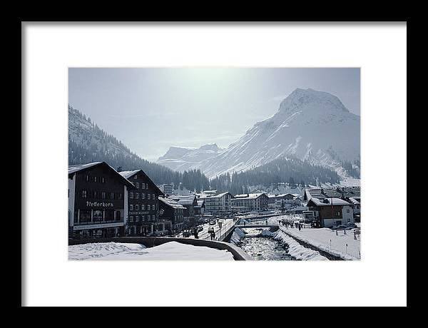 Snow Framed Print featuring the photograph Main Street In Lech by Slim Aarons