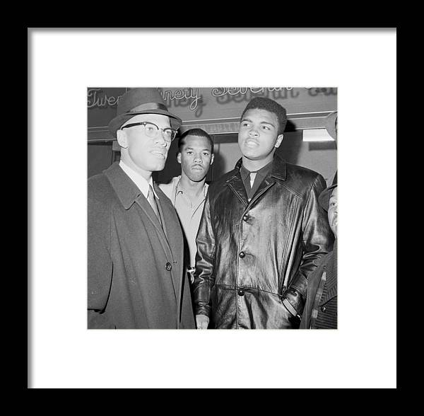 Usa Framed Print featuring the photograph Malcolm X Left With Cassius Marcellus by New York Daily News Archive