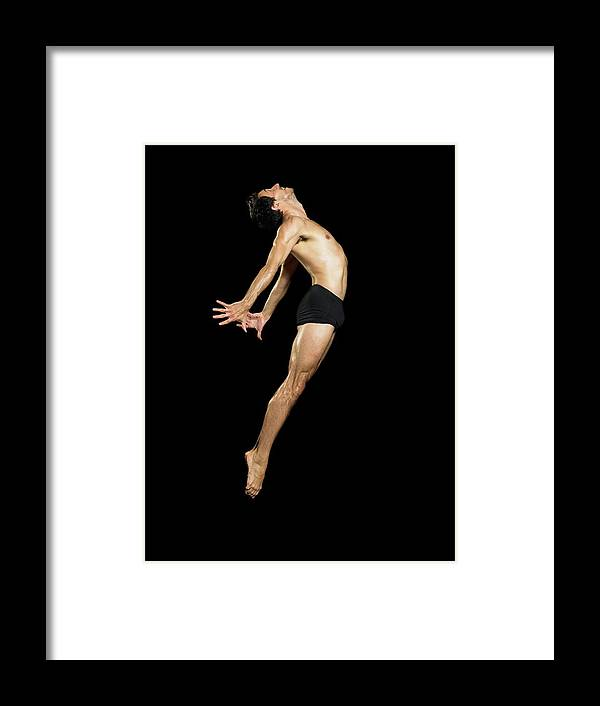 Human Arm Framed Print featuring the photograph Male Dancer Jumping by Image Source