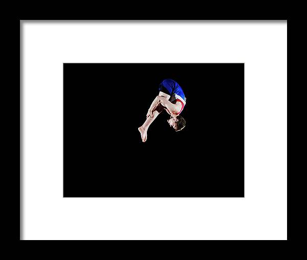Focus Framed Print featuring the photograph Male Gymnast 16-17 Mid Air, Black by Thomas Barwick