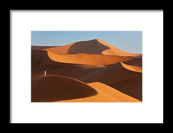 Shadow Framed Print featuring the photograph Man Climbing Sand Dunes, Namib Desert by Peter Adams
