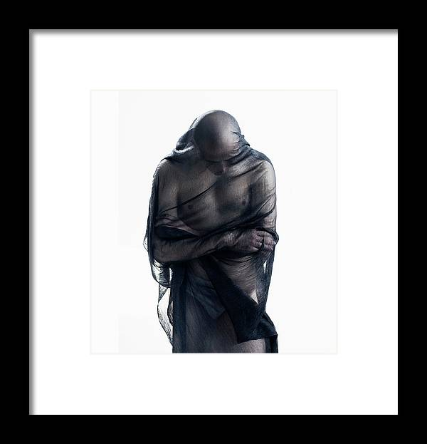 Three Quarter Length Framed Print featuring the photograph Man Covered In Black Material by Tara Moore