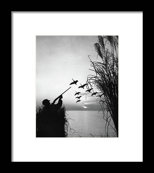 Rifle Framed Print featuring the photograph Man Duck-hunting by Stockbyte
