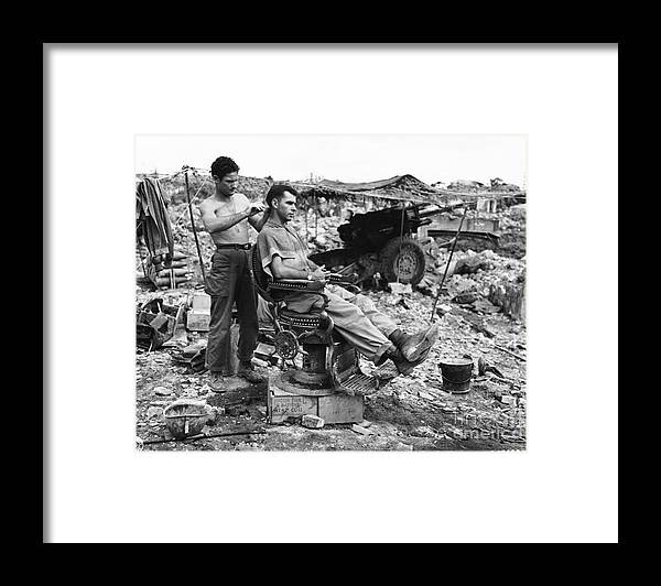 People Framed Print featuring the photograph Man Having Hair Cut In Okinawa by Bettmann
