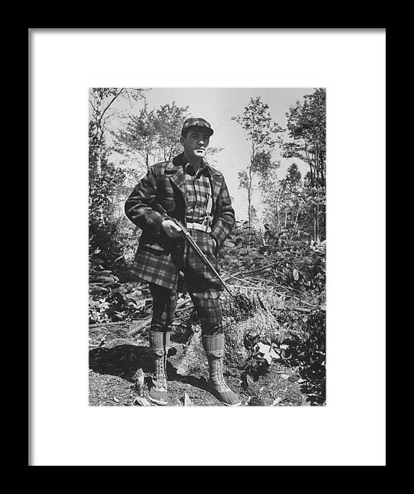 Timeincown Framed Print featuring the photograph Man In Deer Hunting Outfit In Red & Blac by George Strock