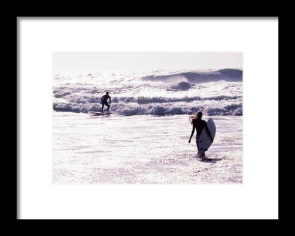 Wind Framed Print featuring the photograph Man Surfing On Sea, Woman Walking With by Johner Images