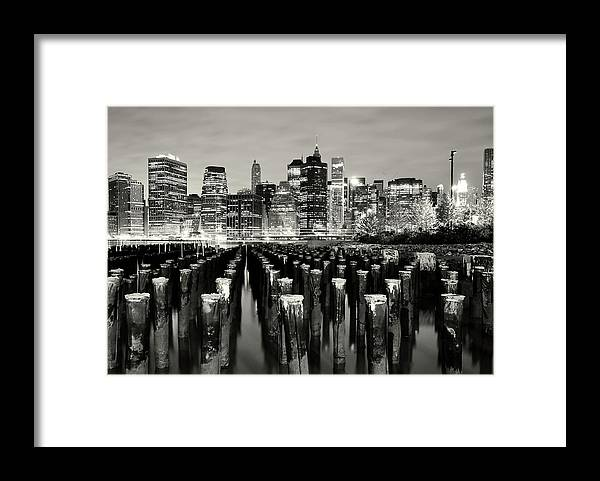 Wooden Post Framed Print featuring the photograph Manhattan At Night by Shobeir Ansari
