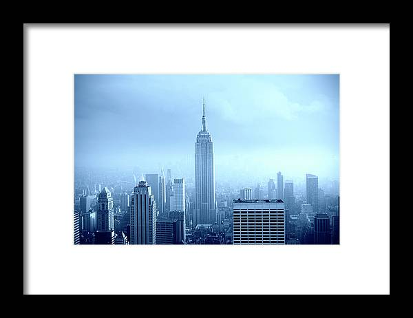 Lower Manhattan Framed Print featuring the photograph Manhattan Skyline In The Fog, Nyc. Blue by Lisa-blue