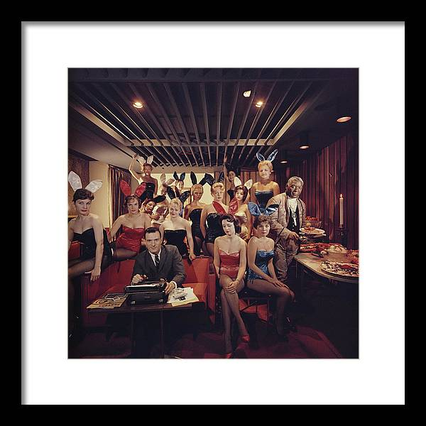 Hugh Hefner Framed Print featuring the photograph Mans Work by Slim Aarons