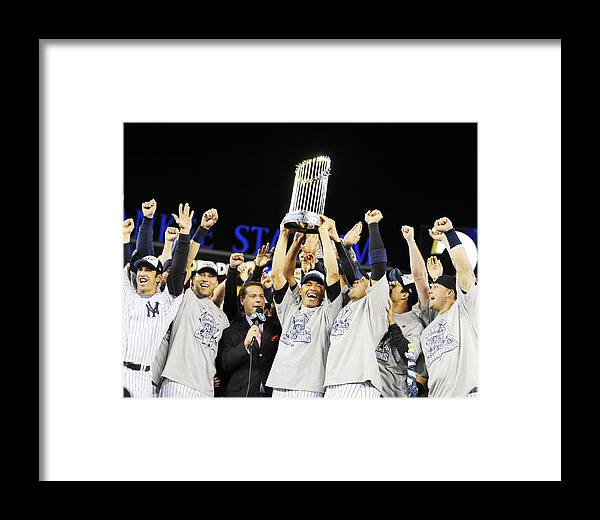 American League Baseball Framed Print featuring the photograph Mariano Rivera Holds Trophy As New York by New York Daily News Archive