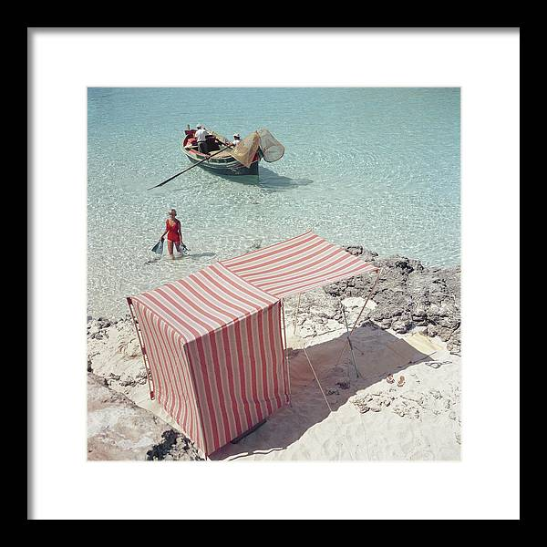 People Framed Print featuring the photograph Marietine Birnie, Blue Lagoon by Slim Aarons