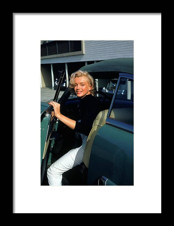 Marilyn Monroe Framed Print featuring the photograph Marilyn Monroe Getting Out Of A Car by Alfred Eisenstaedt