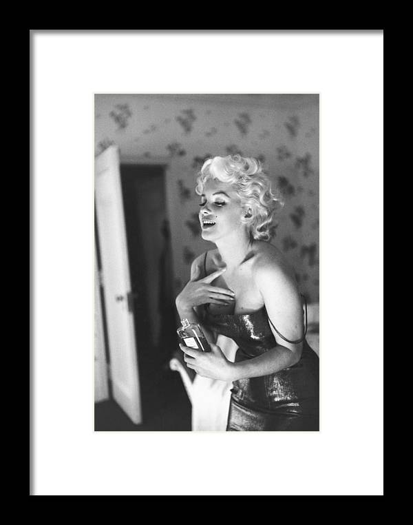 People Framed Print featuring the photograph Marilyn Monroe With Chanel No. 5 by Michael Ochs Archives