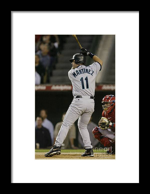 American League Baseball Framed Print featuring the photograph Mariners V Angels by Stephen Dunn